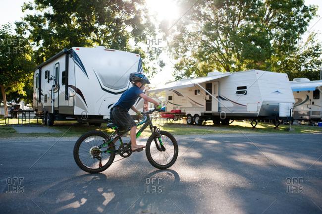 Boy riding bike in a campground