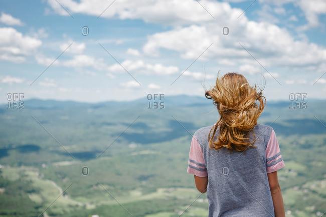 Girl looking over windy vista
