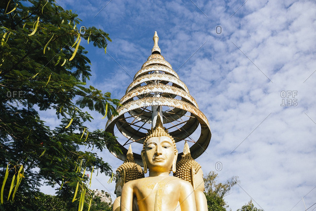 A large golden Buddha at Tham Krabok temple in Saraburi, Thailand.