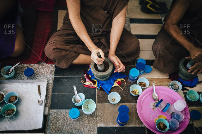 Monks bash herbs and roots into medicine at Tham Krabok temple in Saraburi, Thailand. Aside from drug rehab, the temple also makes other herbal concoctions that are much less poisonous to the body.