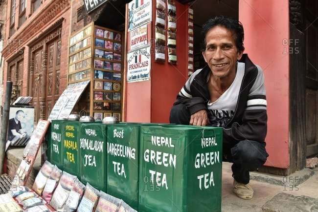 Bhaktapur, Nepal - April 13, 2016: A Nepalese man selling variety of tea, Bhaktapur Nepal