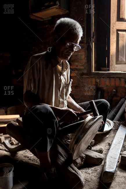 Patan, Nepal - April 15, 2016: Carpenter working in a workshop in Nepal