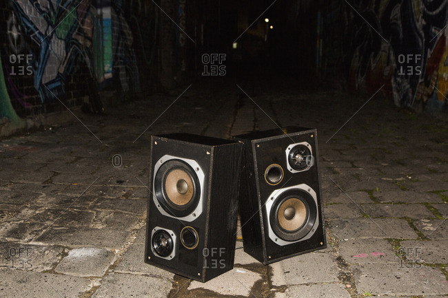 Abandoned speakers on street at night