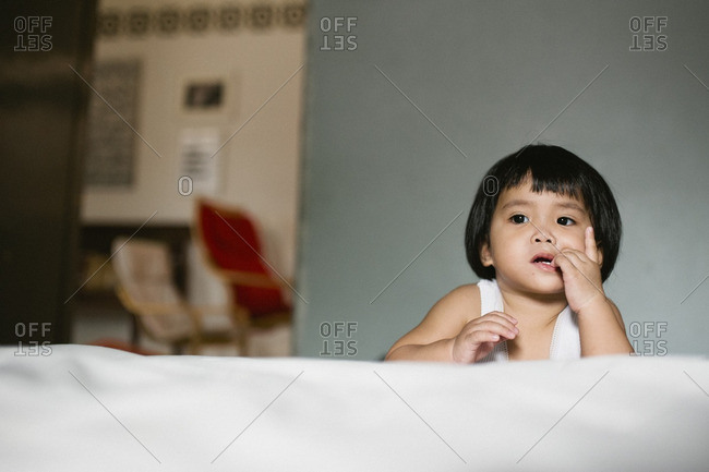 Young toddler boy staring off