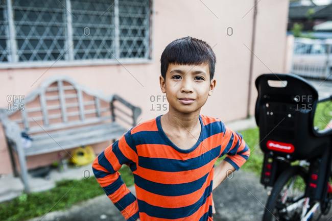 Malaysian boy in his backyard