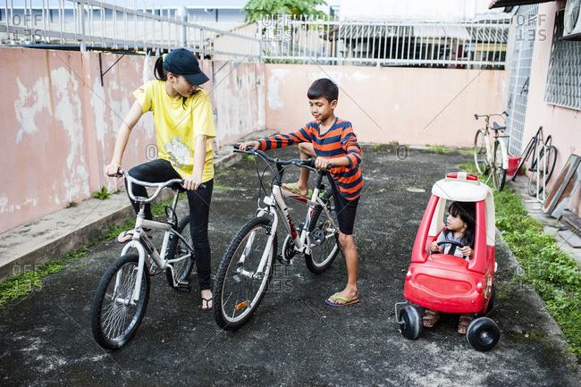 Kids riding bikes in their yard