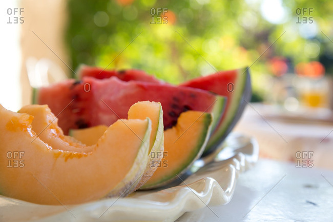 Melon slices on an outdoor table
