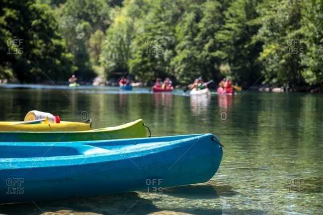 Group of people on river in canoes