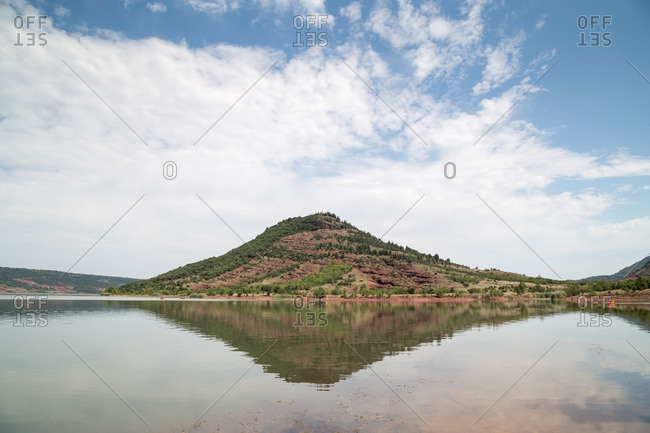 A hill reflected in a lake
