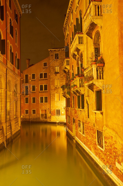 Venice canal glowing at night
