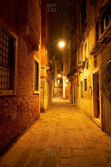 Narrow street at night, Venice, Italy