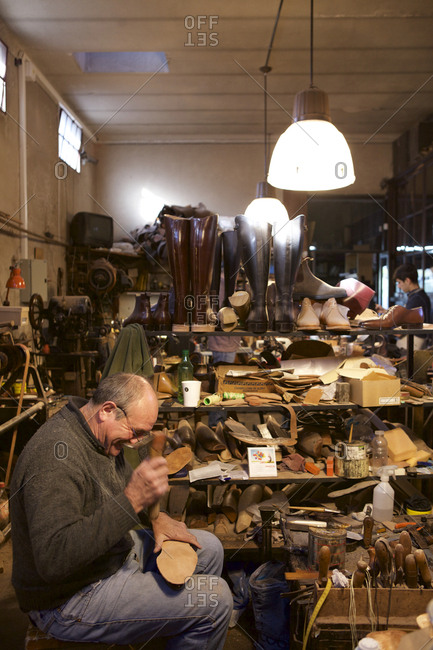 Buenos Aires, Argentina - May 23, 2016: Man making boots by hand