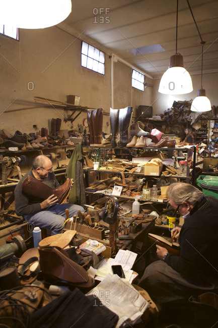 Buenos Aires, Argentina - May 23, 2016: Men making boots by hand