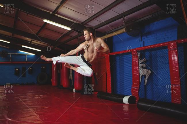Karate practicing kickboxing in fitness studio