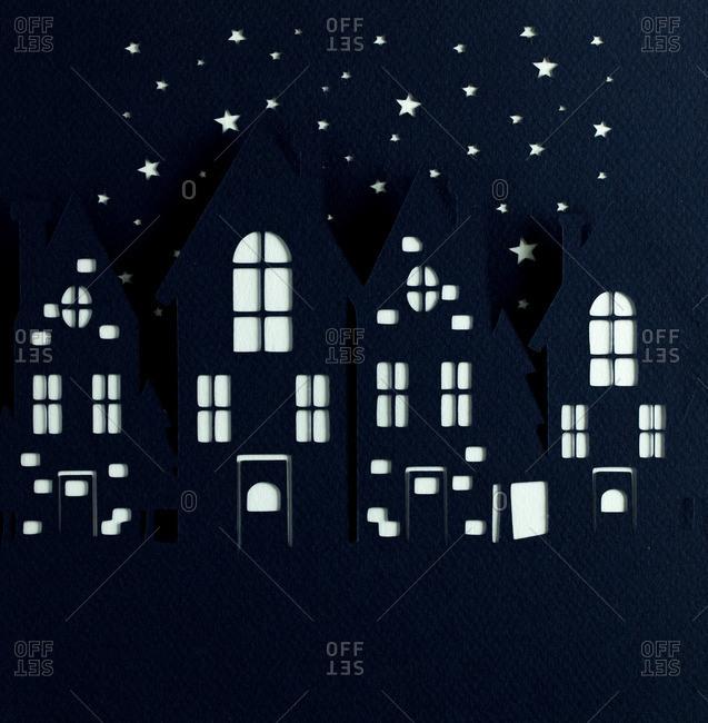 Nighttime sky over buildings