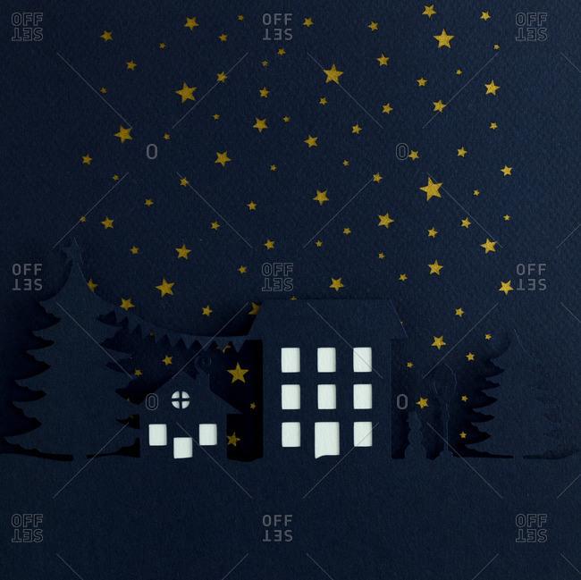 Nighttime Christmas scene with starry sky