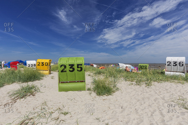 Wangerland, Germany - June 7, 2016: Colorful wicker shelters on a beach