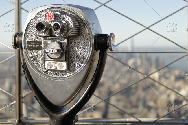 New York City, United States - June 7, 2016: Observation binoculars overlooking Manhattan