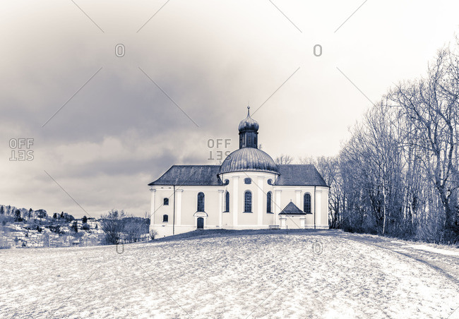 Church on a hillside dusted with snow