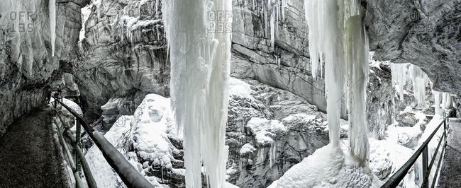 Pathway through a rock formation covered with ice