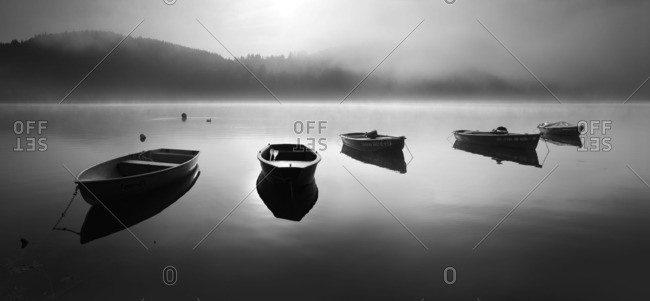 Hesse, Germany - March 5, 2016: Empty rowboats in the morning mist