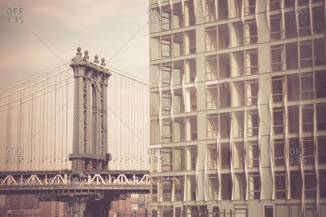 Tower of the Manhattan Bridge and a commercial office building