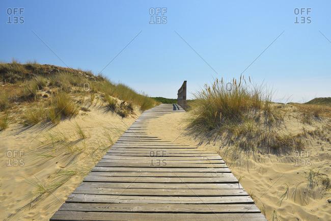 Boardwalk through sand dunes and beach grass at Nebel, Germany