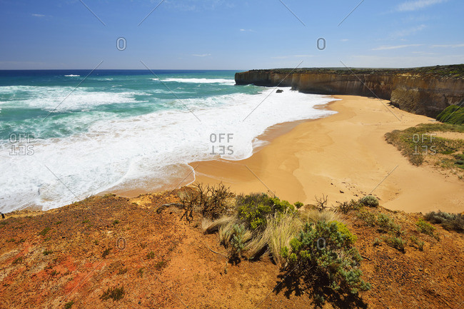 Sandy coastline and limestone cliffs at a deserted beach in Australia