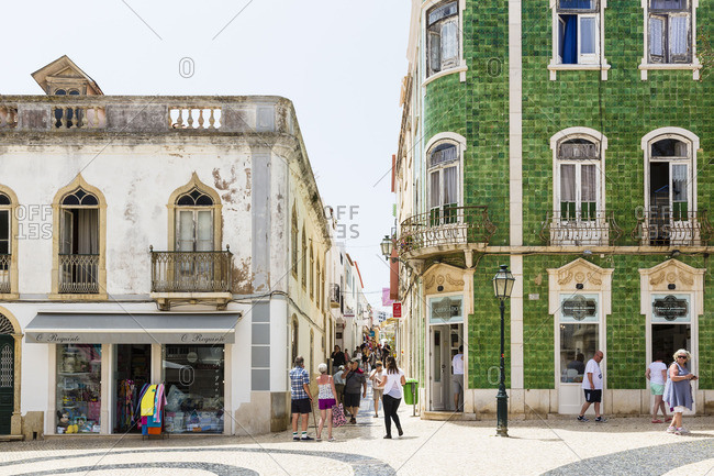 Lagos, Portugal - June 7, 2016: Shops in a building with green azulejos tiles at Praca Luis de Camoes Square