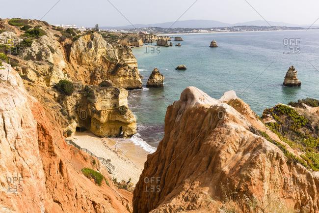 Coastline cliffs and rock formations at Praia do Camilo, Lagos, Portugal