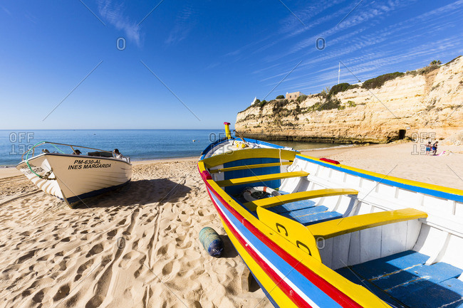 Lagoa, Portugal - June 7, 2016: Colorful fishing boats on the beach at Praia da Senhora da Rocha