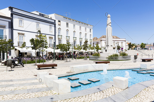 Tavira, Portugal - June 7, 2016: Fountain and monument at Prace da Republica public square