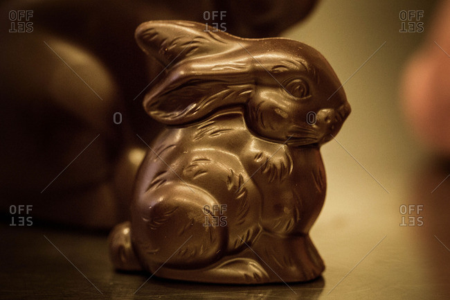 Chocolate rabbit on a metal surface