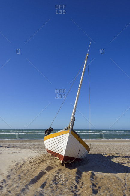 Single fishing boat on the beach at Fjerritslev, Denmark
