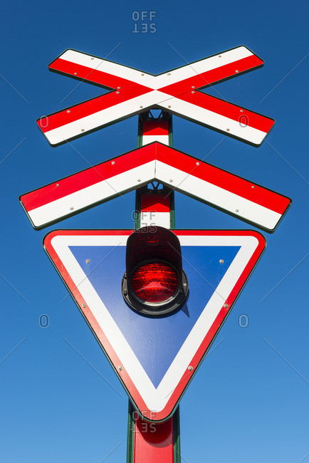 Red and white Danish railway crossing sign