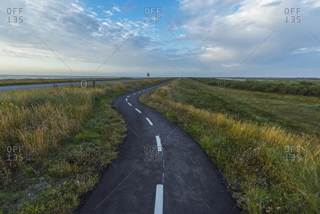 Winding bikeway through fields in Thy National Park, Denmark
