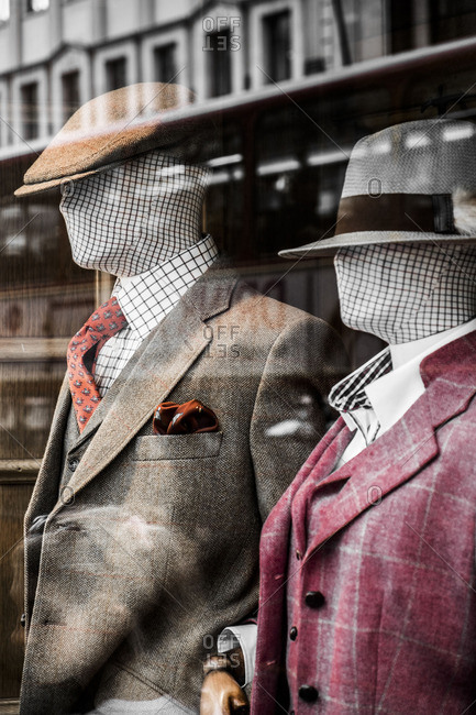 London, England - June 7, 2016: Mannequins in the window of a men's clothing store