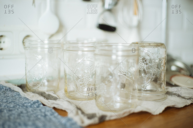 Glass jars for canning drying on a towel