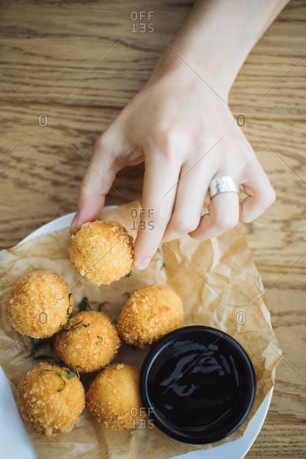 Woman eating cheese balls