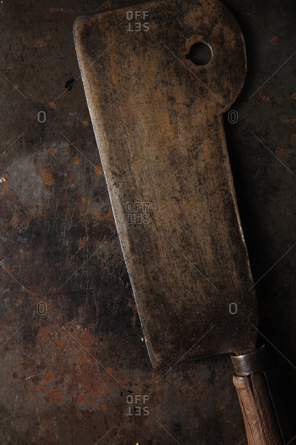 Old cleaver on a rustic background