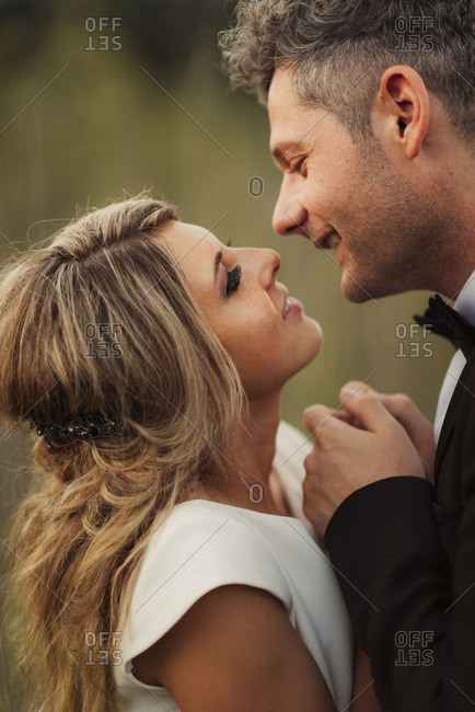 Bridal couple in tender embrace