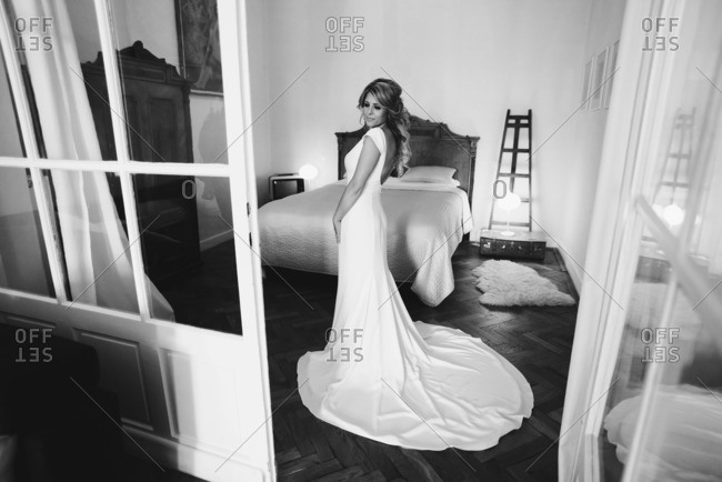 Bride in her gown in bedroom