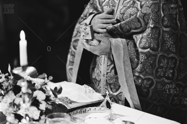 Priest's hands at altar during wedding