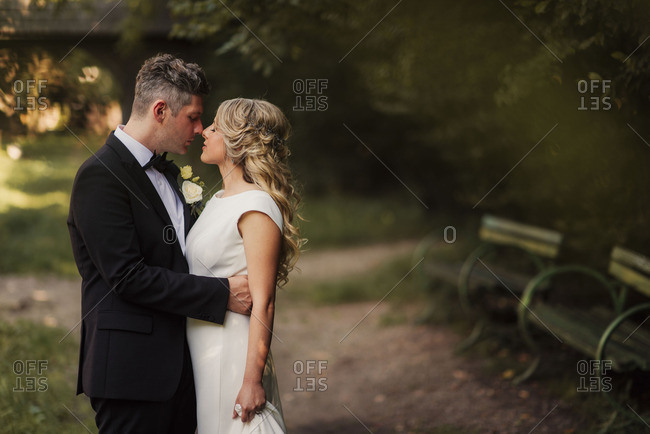 Bridal couple in passionate embrace