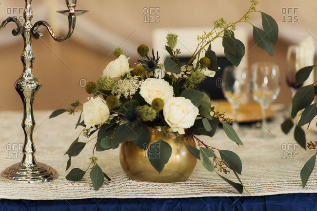 Flowers and a candelabra on table
