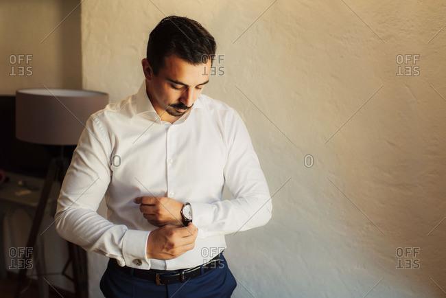 Groom putting on a wristwatch