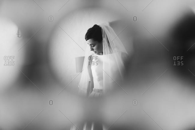 A bride seen in circular hole