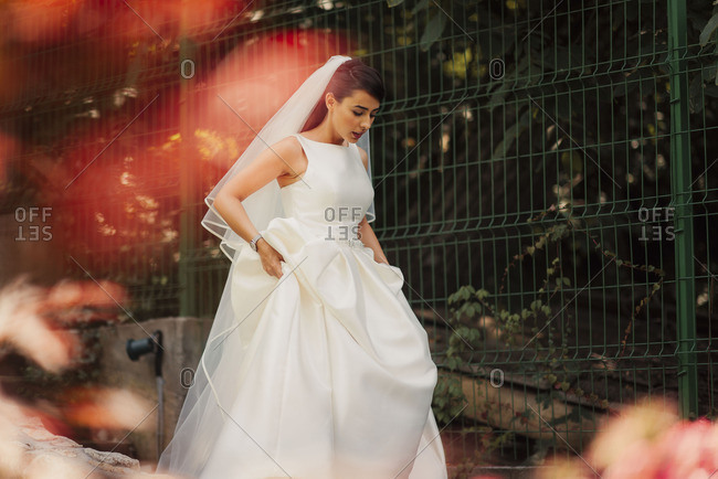 Bride walking holding up dress