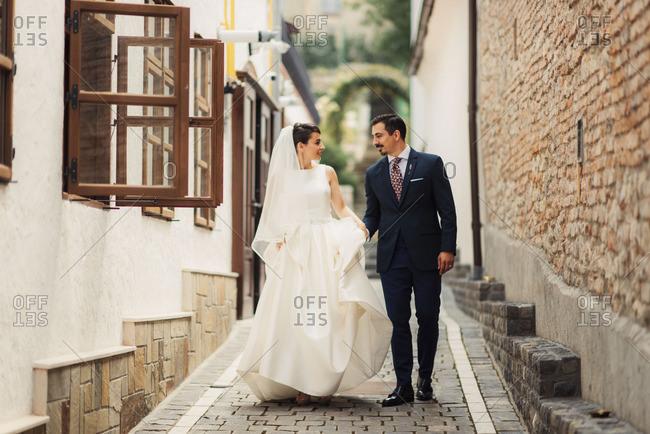 Bridal couple walking down lane