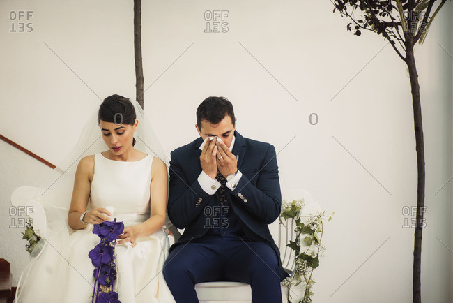 Bride and groom crying during ceremony